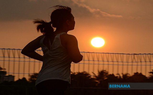 a woman running during sunset